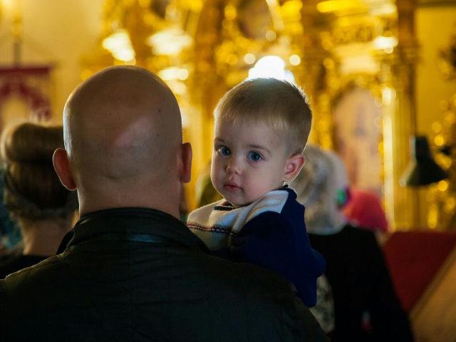 Папа и малыш в храме