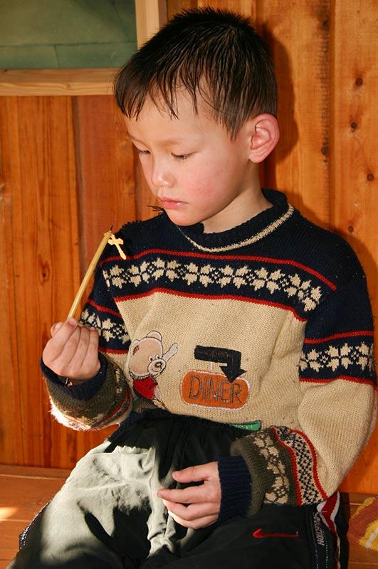 мальчик с крестиком