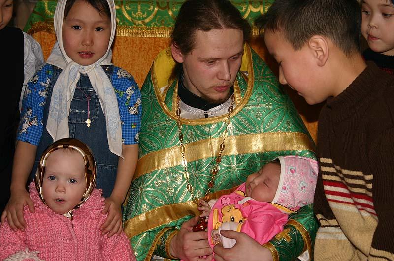 Священник и малыш